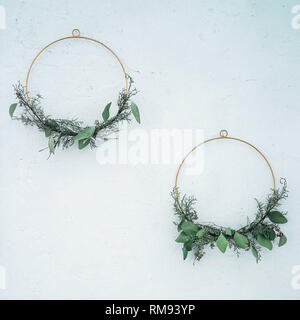 Spring or summer decor on the wall, DIY wreath of green branches - Stock Photo