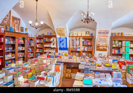 KRAKOW, POLAND - JUNE 21, 2018: The large Jewish book shop with variety of books, magazines, postcards, posters and other souvenirs on Jewish theme, o - Stock Photo