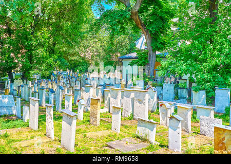 The medieval Old Jewish Cemetery with damaged inscriptions and carvings on the tombstones, Krakow, Poland - Stock Photo