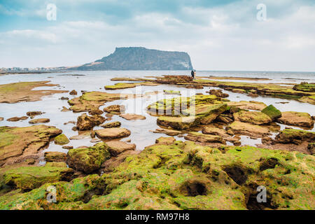 Seongsan Ilchulbong Tuff Cone and Gwangchigi Beach in Jeju Island, Korea - Stock Photo