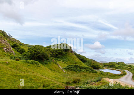 Discover the enchanted geological landscape of Fairy Glen. It looks like it could be the home to magical faeries. Travel to the Isle of Skye Scotland. - Stock Photo