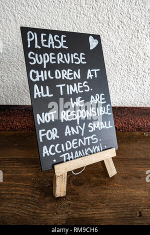 Hand written sign on a blackboard in an English cafe - Stock Photo