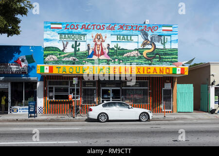 A car parked outside a colorful Mexican restaurant on SW 8th street in Miami, Florida. - Stock Photo
