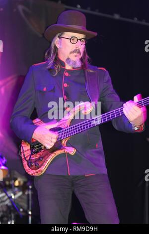 Bassist Les Claypool is shown performing on stage during a 'live' concert appearance with The Claypool Lennon Delirium. - Stock Photo