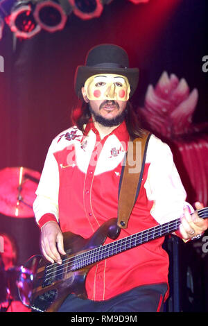 Multi-instrumentalist, novelist, music producer, actor, and film director, Leslie Edward 'Les' Claypool, best known for his work with the band Primus, is shown playing his bass guitar during a 'live' concert appearance with his solo band. - Stock Photo