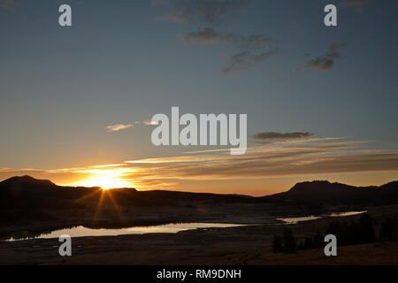 WY03714-00...WYOMING - The sun rising over Chain Lakes viewed from Forest Road 149 near the Beartooth Highway in the Shoshone National Forest. - Stock Photo