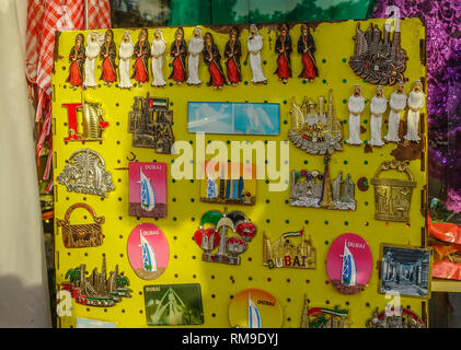 Dubai, UAE - Dec 5, 2018. Colorful magnet souvenirs in Dubai Market. As of 2018, Dubai is the fourth most-visited city in the world. - Stock Photo
