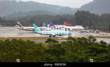Boeing Pegasus takes off in the rain - Stock Photo