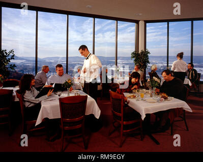 Waiters and customers in the 'Top of the 80's' restaurant, Hazleton, Pennsylvania, USA - Stock Photo