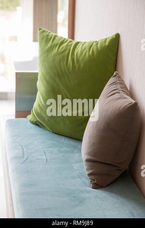 Cushions in green and brown hotel indoor. Majorca, Balearic Islands, Spain. - Stock Photo