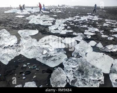 Diamond beach with icebergs at the Glacier lagoon of Jokulsarlon, Iceland - Stock Photo