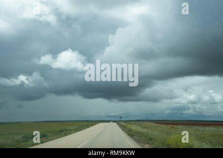 Desert road thunderstorm Castile Leon Spain - Stock Photo