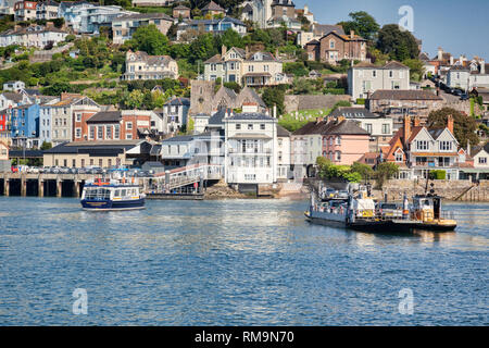 23 May 2018: Dartmouth, Devon, UK - The Lower Ferry, crossing the River Dart and approaching Kingswear. Tug which steers it across can be seen alongsi - Stock Photo