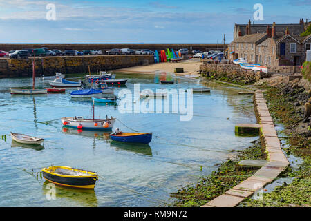 15 June 2018: Mousehole, Cornwall, UK - The harbour, and harbourside cottages. - Stock Photo