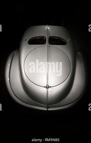 Back of old vintage car with a streamlined aerodynamic body shape with large fenders and convex lights inherent in the design of retro cars and geomet - Stock Photo