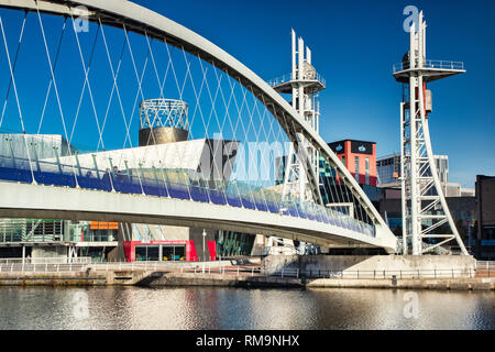 2 November 2018: Salford Quays, Manchester, UK - The Lowry Bridge on a lovely sunny autumn day, with clear blue sky. - Stock Photo