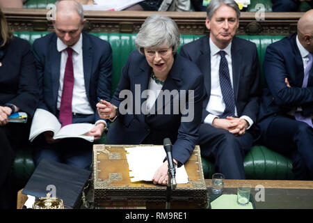 London, Britain. 13th Feb, 2019. British Prime Minister Theresa May attends the Prime Minister's Questions in the House of Commons in London, Britain, Feb. 13, 2019. Credit: UK Parliament/Jessica Taylor/Xinhua/Alamy Live News - Stock Photo