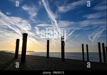 Brighton, UK. 14th Feb, 2019. A beautiful sunny morning on Brighton seafront by the old West Pier pillars as mild warm weather is forecast to spread across Britain with temperatures expected to reach the mid teens centigrade in some areas Credit: Simon Dack/Alamy Live News - Stock Photo