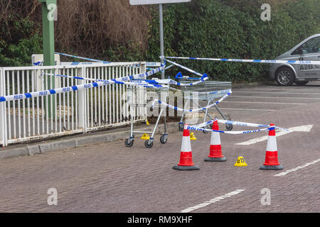 Trowbridge, Wiltshire, UK. 14th February 2019. Overnight there was a double stabbing near the Tesco Extra store. One victim rumoured to be critical. Details of trollys cones and crime scene markers around an area of special interest Credit: Starsphinx/Alamy Live News - Stock Photo