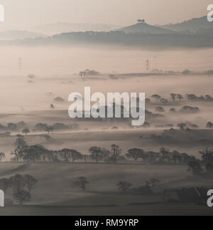 Marshwood Vale, Dorset, UK. 14th February 2019.  UK Weather: The early morning mist rises from the fields of Marshwood Vale looking out  towards the iconic Colmers Hill in the distance. Credit: Celia McMahon/Alamy Live News - Stock Photo