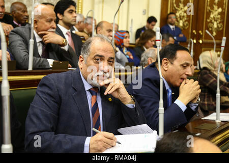 Cairo, Egypt. 14th Feb 2019. Abdel Hadi Al Kasabi (L), head of the Egypt Support Coalition, the Egyptian Parliament's majority bloc, attends a session during which Parliament members are voting on the proposed constitutional amendments that will increase the country's President term in office from four to six years after deliberations a day earlier. Credit: dpa picture alliance/Alamy Live News - Stock Photo