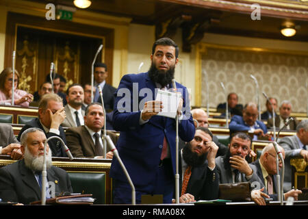Cairo, Egypt. 14th Feb 2019. MP Mohamed Salah Khalifa of Al-Nour ultra-conservative Islamist party speaks at a session of the Egyptian Parliament during which Parliament members are voting on the proposed constitutional amendments that will increase the country's President term in office from four to six years after deliberations a day earlier. Credit: dpa picture alliance/Alamy Live News - Stock Photo