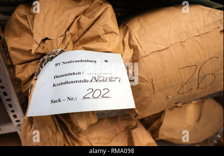 Neubrandenburg, Germany. 05th Feb, 2019. In the archive in the Neubrandenburg branch office of the authority of the Federal Commissioner for Stasi Files (BStU) there are paper bags with torn files. Many of the sacks come from the former Stasi district office Waren. The St. George's Church in Waren is to become the central memorial site for the peaceful revolution of 1989. Credit: Bernd Wüstneck/dpa-Zentralbild/ZB/dpa/Alamy Live News - Stock Photo
