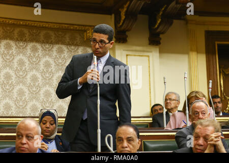 Cairo, Egypt. 14th Feb 2019. MP Haitham Al-Hariri of the 25-30 Alliance speaks at a session of the Egyptian Parliament during which Parliament members are voting on the proposed constitutional amendments that will increase the country's President term in office from four to six years after deliberations. If MPs voted in favour, the amendments will be referred to the Legislative and Constitutional Affairs Committee to be discussed in detail and finalized before being referred to the President to be put up for a public vote in a national referendum. Credit: dpa picture alliance/Alamy Live News - Stock Photo