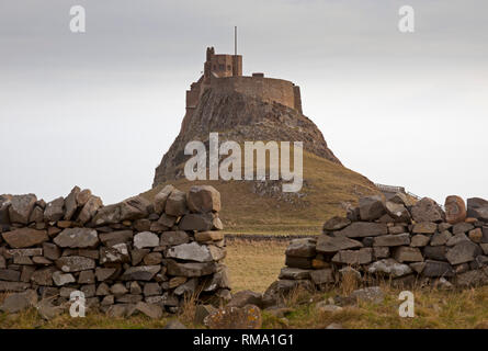 Lindisfarne Castle, Holy Island, Northumberland, England, UK. 14th February 2019. Hundreds of visitors descend on Holy Island as the scaffolding has finally been removed from the exterior castle walls after four years of painstaking renovation and conservation work. The  work cost over three million  pounds and involved removing and restoring 108 windows. Credit: Arch White/Alamy Live News - Stock Photo