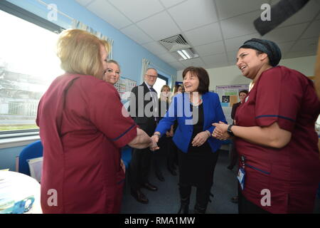 Kilmarnock, UK. 14 February 2019.(L-R) Linda Rimmer - Midwife; Jean Davis - Midwife; Colin McDowall - Chief Executive South Lanarkshire Council; Health Secretary - Jeane Freeman; Attica Wheeler - Head of Midwifery Associate Nurse Director, NHS Ayrshire and Arran. Transforming maternity and neonatal care across Scotland Cabinet Secretary for Health Jeane Freemanl visits Crosshouse Hospital in NHS Ayrshire and Arran to announce a £12 million investment which will ensure mums, babies and other family members are all supported from pregnancy to birth and after. This includes testing a new model - Stock Photo
