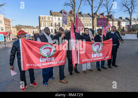 London, UK. 14th February 2019. Goldsmithsmembers of the Independent Workers Union of Great Britain's (IWGB) Security Guards and Receptionists pose in outside the main building as  IWGB union and students launch their campaign for Goldmsiths, University of London, to directly employ its security officers. Currently they are employed by CIS Security Ltd on low pay and minimal conditions of service, and CIS routinely flouts its legal responsibilities on statutory sick pay and holidays. Credit: Peter Marshall/Alamy Live News - Stock Photo