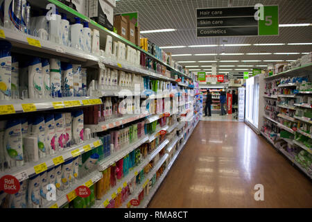 BIRMINGHAM, UK - March 2018 ASDA Customers Shopping for Personal Care Products. Red Discount Tags on Selected items. Aisle Section of Toiletries in Su - Stock Photo