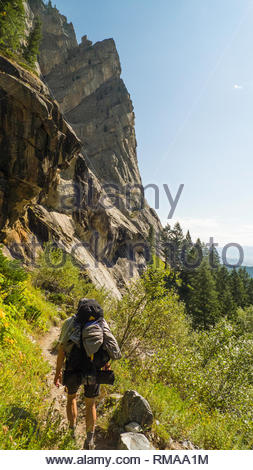 Backpacker on Death Canyon trail, Grand Teton National Park, Teton County, Wyoming, USA - Stock Photo