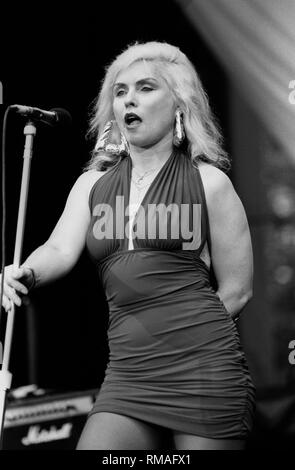 Singer, songwriter and actress Debbie Harry, best known for being the lead singer of the punk rock and new wave band Blondie, is shown performing on stage during a 'live'concert appearance. - Stock Photo