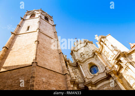The belfry, known as Micalet, and the iron doors of the Saint Mary's Cathedral or Valencia Cathedral in Valencia, Spain - Stock Photo