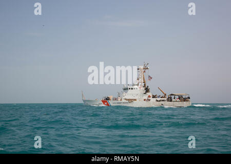 ARABIAN GULF (Jan. 24, 2019) The Island-class patrol boat USCGC Maui (WPB 1304) navigates through the Arabian Gulf. The U.S. 5th Fleet area of operations encompasses nearly 2.5 million square miles of water area and includes the Arabian Gulf, Gulf of Oman, Red Sea and parts of the Indian Ocean. The region is comprised of 20 countries and includes three critical choke points at the Strait of Hormuz, the Suez Canal and the Strait of Bab-al-Mandeb at the southern tip of Yemen. (U.S. Army photo by Spc. Meleesa Gutierrez/Released) - Stock Photo
