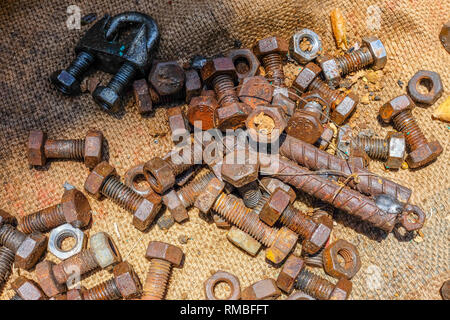 Much of Nuts and bolts closeup, on sackcloth - Stock Photo