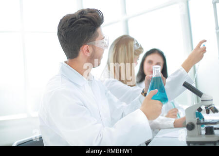 male researcher carrying out scientific research in a lab - Stock Photo