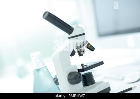 close up.microscope on the table in the science lab. - Stock Photo