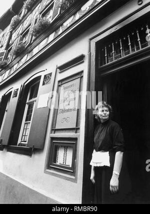 Christina Trum, hostess of the Schlenkerla tavern in Bamberg at Dominikanerstrasse 6. There you will find the famous Rauchbier (smoked beer). - Stock Photo