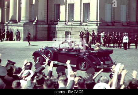 Adolf Hitler in a car while driving in Munich. The picture was taken when Mussolini was visiting Munich in 1940. - Stock Photo