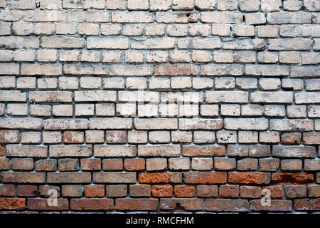 Old brick wall as background horizontal view closeup - Stock Photo