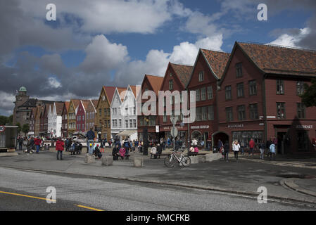 Bryggen is a row of hanseatic commercial buildungs along the eastern coastline of the fjord coming into the Norwegian city of Bergen. - Stock Photo