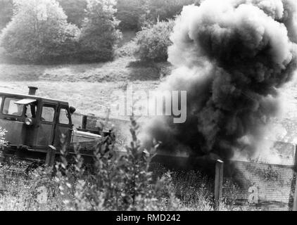 One of the mines explodes during the clearance of anti-personnel mines in the death strip on the border in the Eichsfeld. - Stock Photo
