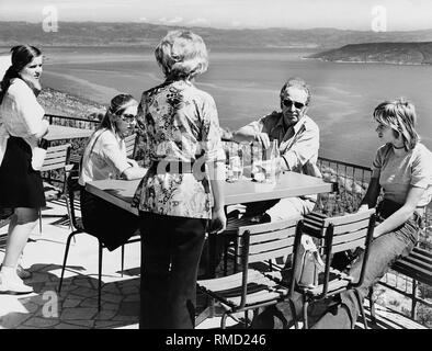 Family in a tourist restaurant overlooking the Gulf of Rijeka on the Adriatic coast. - Stock Photo