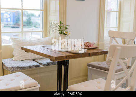 Dirty empty dish and glass on the table in the beautiful cafe after eating - Stock Photo