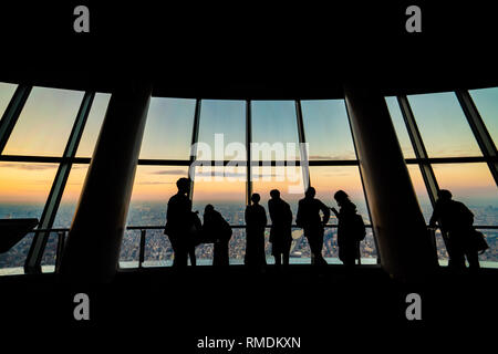 sunset views, tourists at Tembo Deck observation deck. The Tokyo Skytree is a television broadcasting tower and landmark of Tokyo. Concept of travel a - Stock Photo