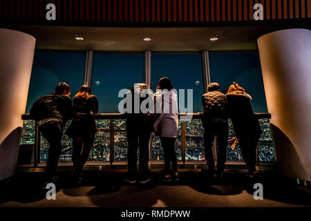 Tokyo, Japan - November 22, 2018: tourists at Tembo Deck observation deck. The Tokyo Skytree is a television broadcasting tower and landmark of Tokyo. - Stock Photo