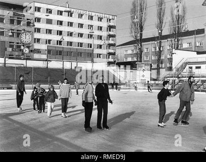 Skaters on the ice rink in Prinzregentenstadion. - Stock Photo
