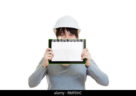 Young man engineer wearing protective helmet new project presentation cover half face using a tablet computer gadget isolated over white background. H - Stock Photo
